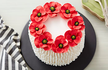 White buttercream cake with red buttercream poppies