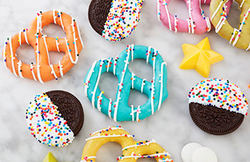 Pretzels and cookies dipped in Candy Melts Candy