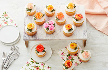 The Wilton Rose piped on ice cream cone cupcakes